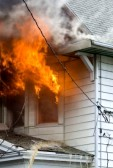 15723842-flames-and-smoke-of-a-bad-house-fire